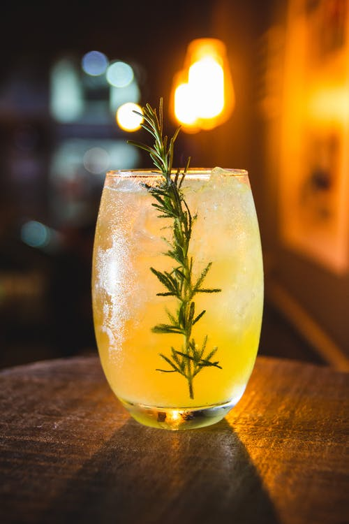 Drink With Rosemary Herb In Clear Glass