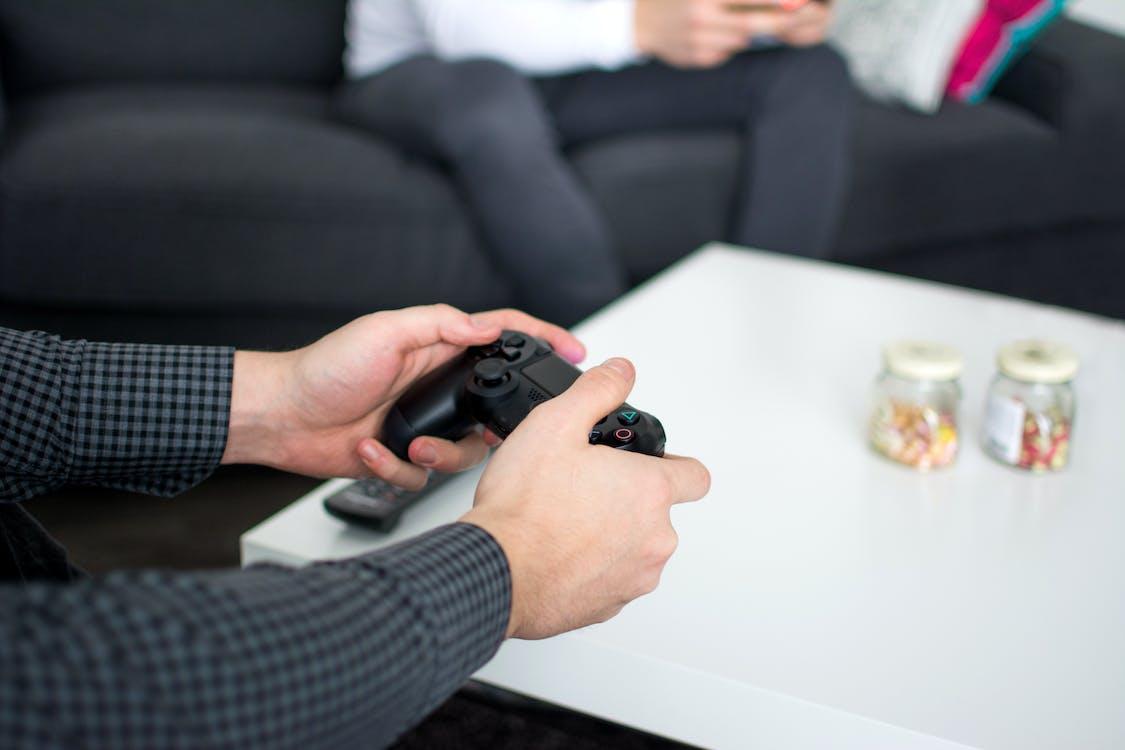 Person Holding Black Dualshock4 Controller