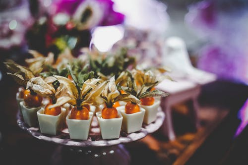 White and Orange Party Favors in Tray