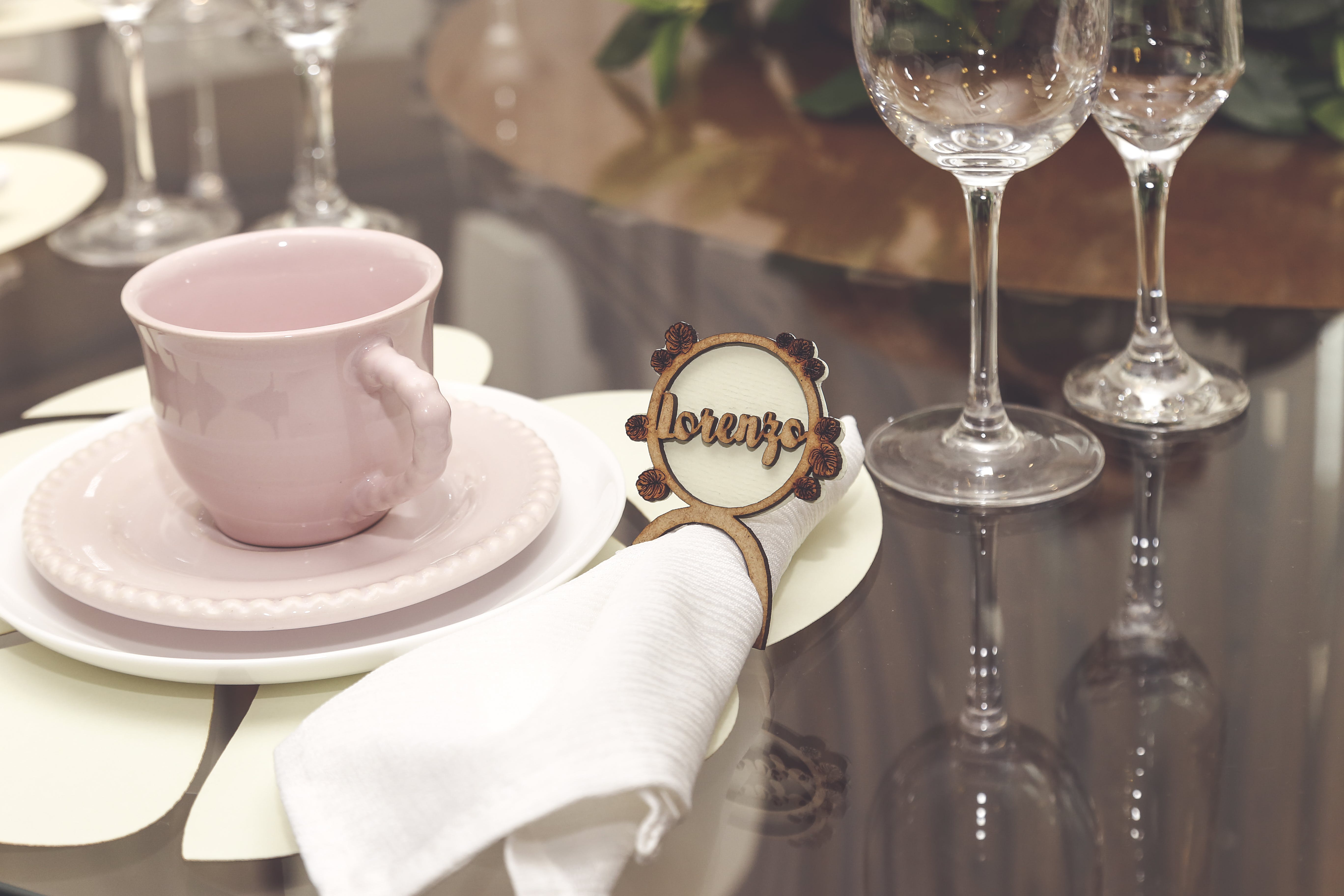 Pink Ceramic Cup With Saucer Besides White Napkin