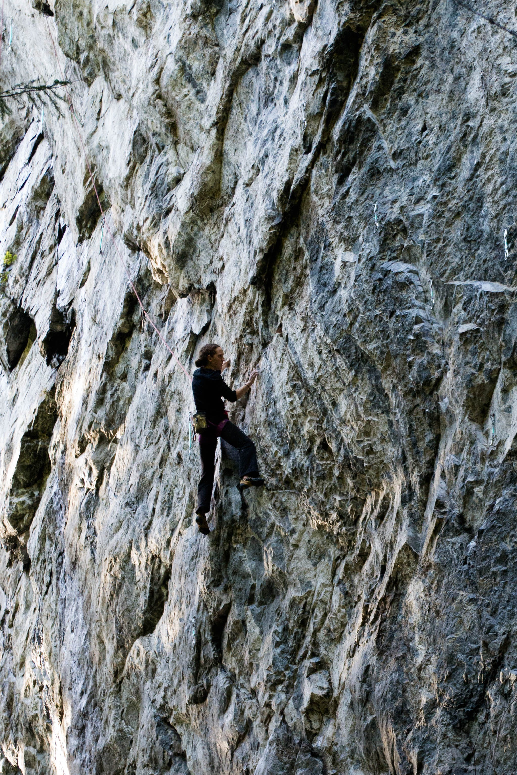Person Climbing on Rock Mountain