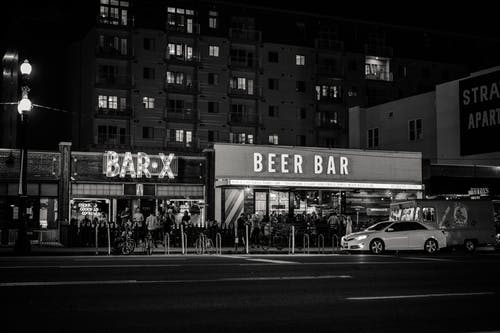 Grayscale Photo of Beer Bar Signage
