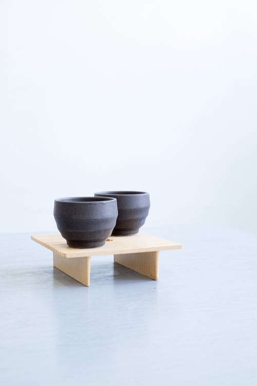 Gray Ceramic Bowl on Brown Wooden Rack