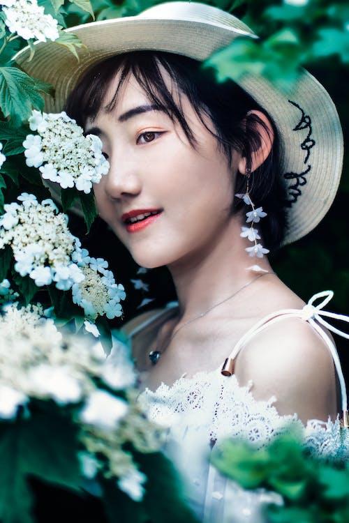 Photo of Woman Near White Flowers