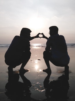 Silhouette of 2 Man Making Heart Sign