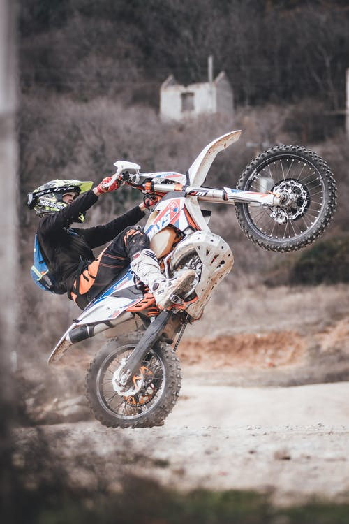 Man Riding Motocross Dirt Bike