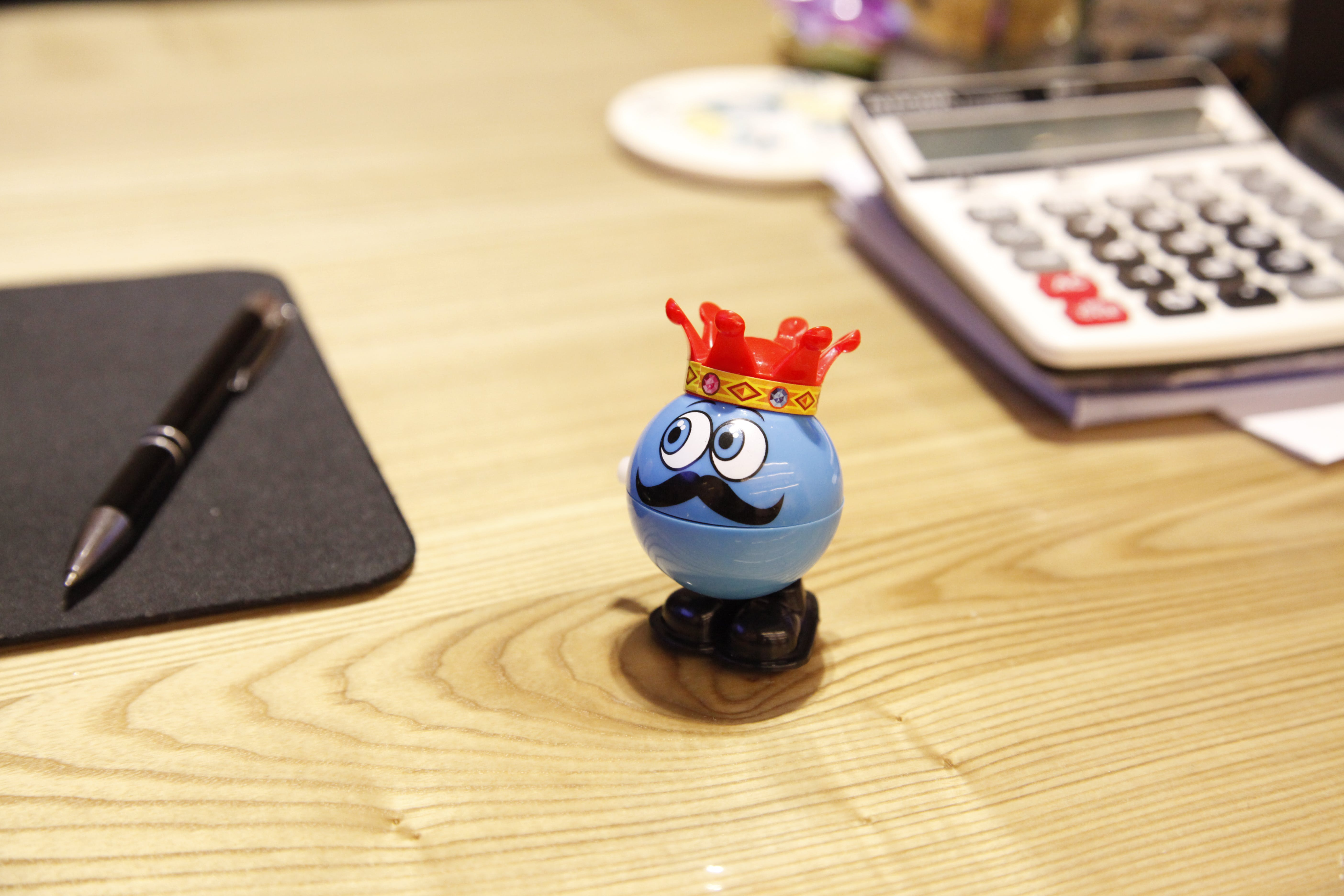 Blue Round Plastic Toy on a desk