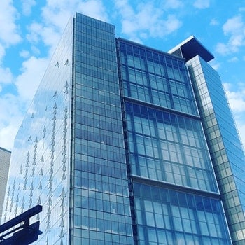 Low Angle View of Glass High Rise Building during Cloudy Daytime Photo