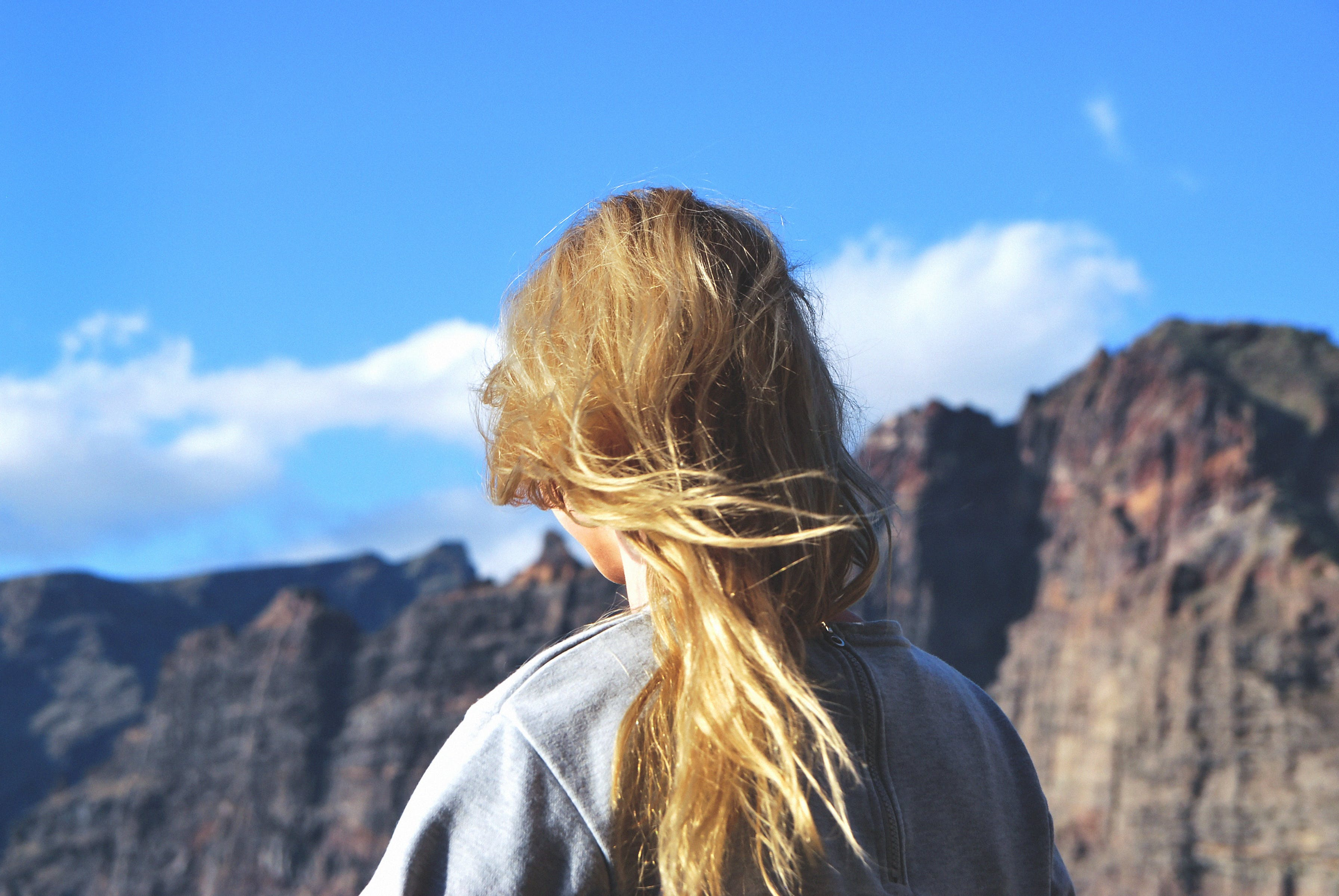Woman Standing With Mountain As Background