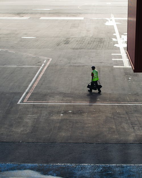 man walking on tarmac