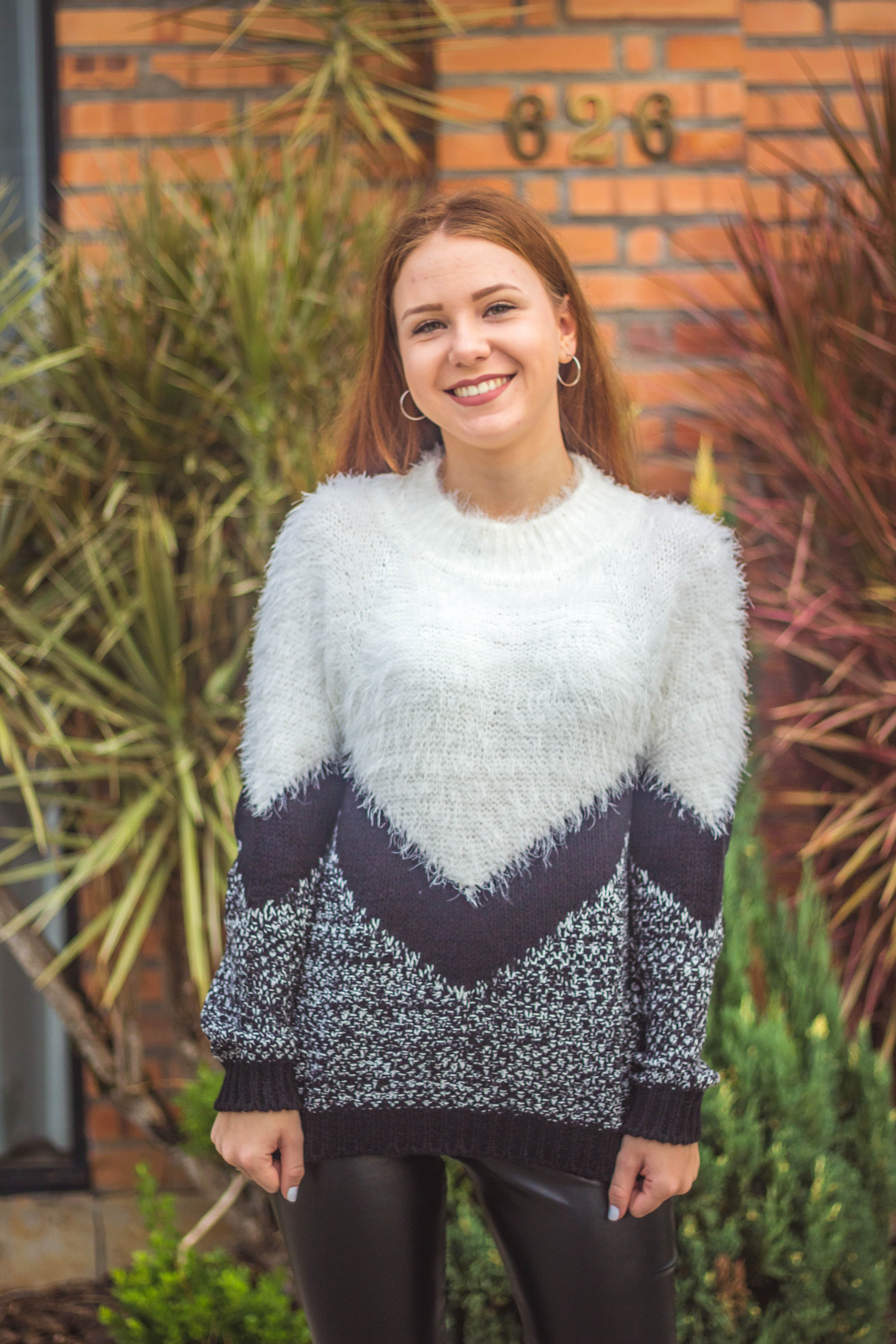 Woman Wearing a Knitted Sweater