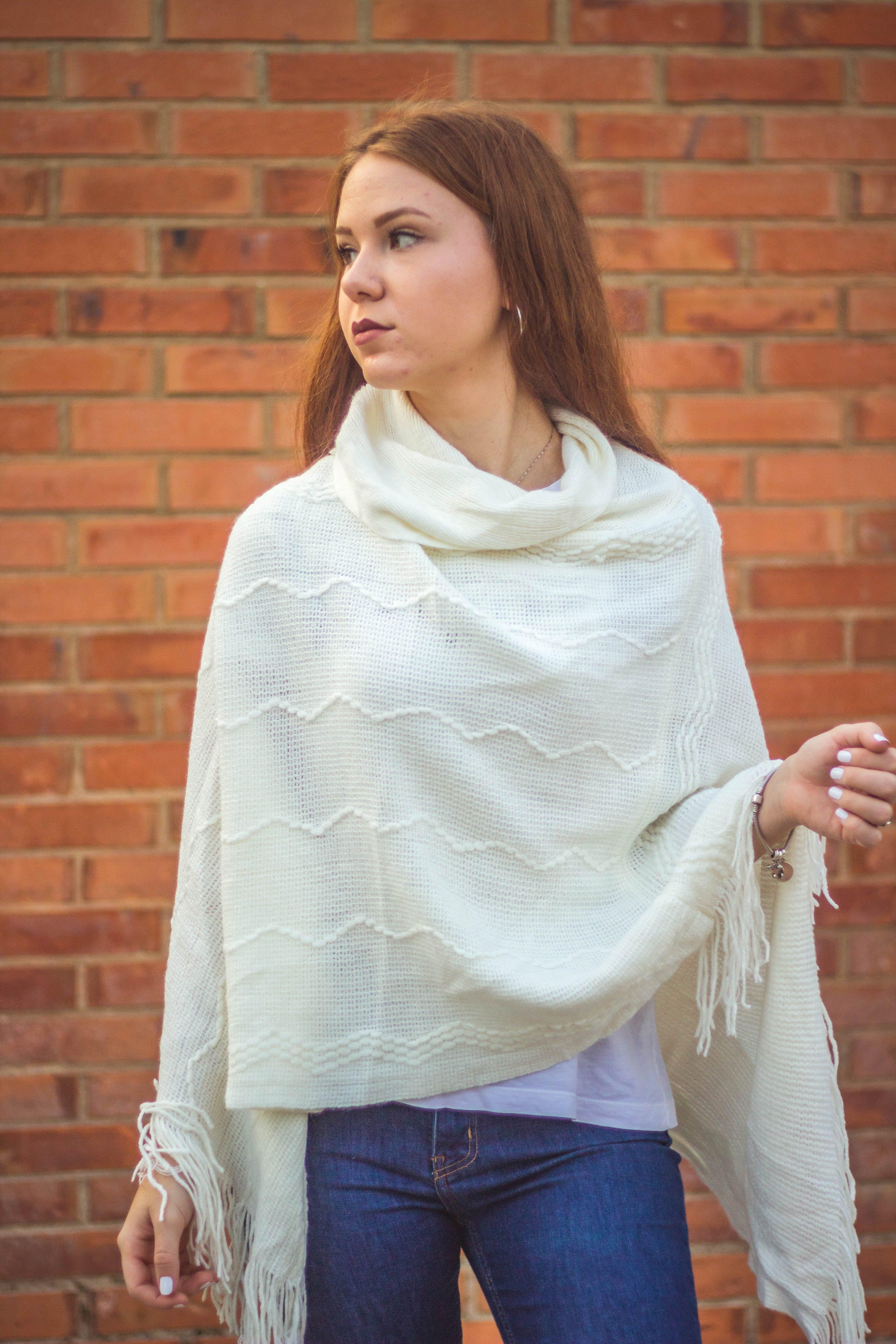 Woman wearing a white shawl looking sideways