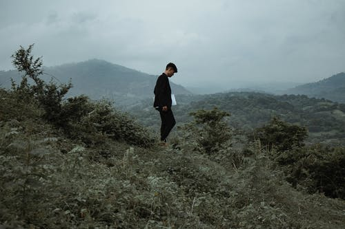 Person Standing in Mountain
