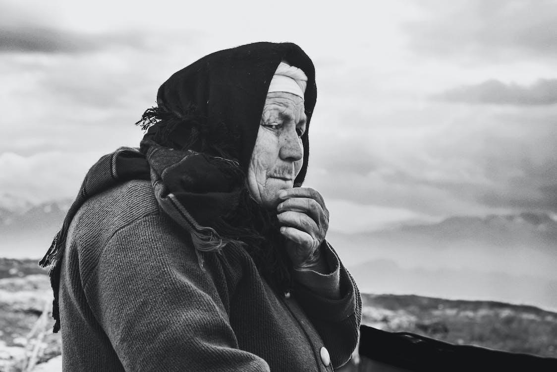 Gray Scale Photo of Woman Wearing Black Hijab