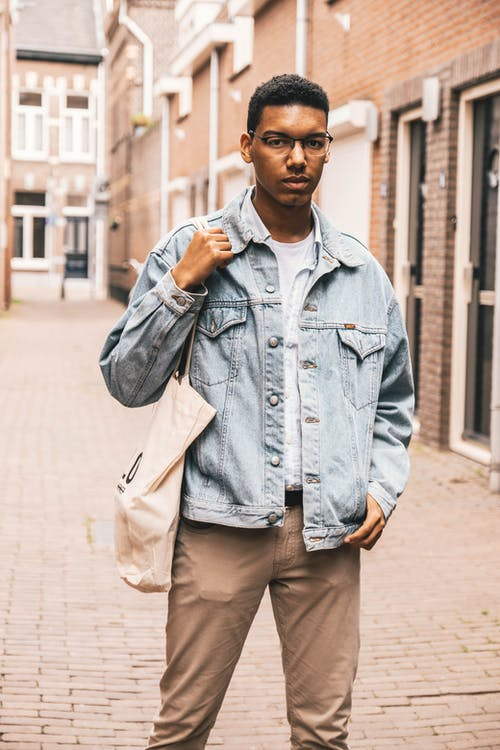 Man Wearing Gray Denim Jacket