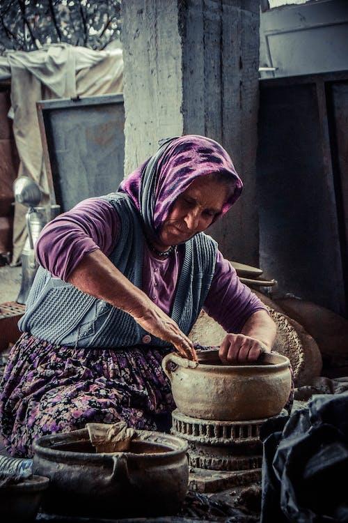 Woman Molding Brown Clay Pot