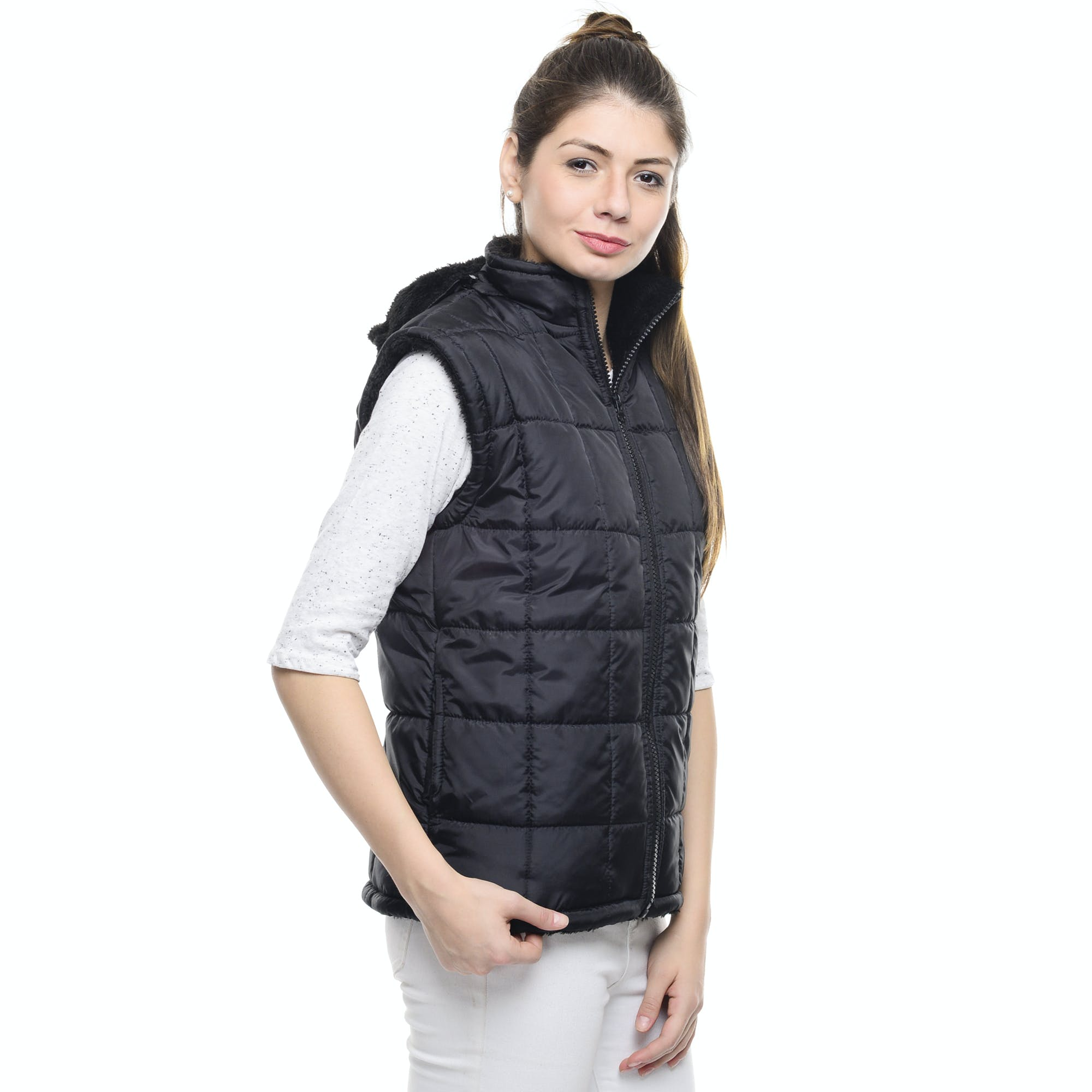 Woman Standing Wearing Black Bubble Zip Turtleneck Vest