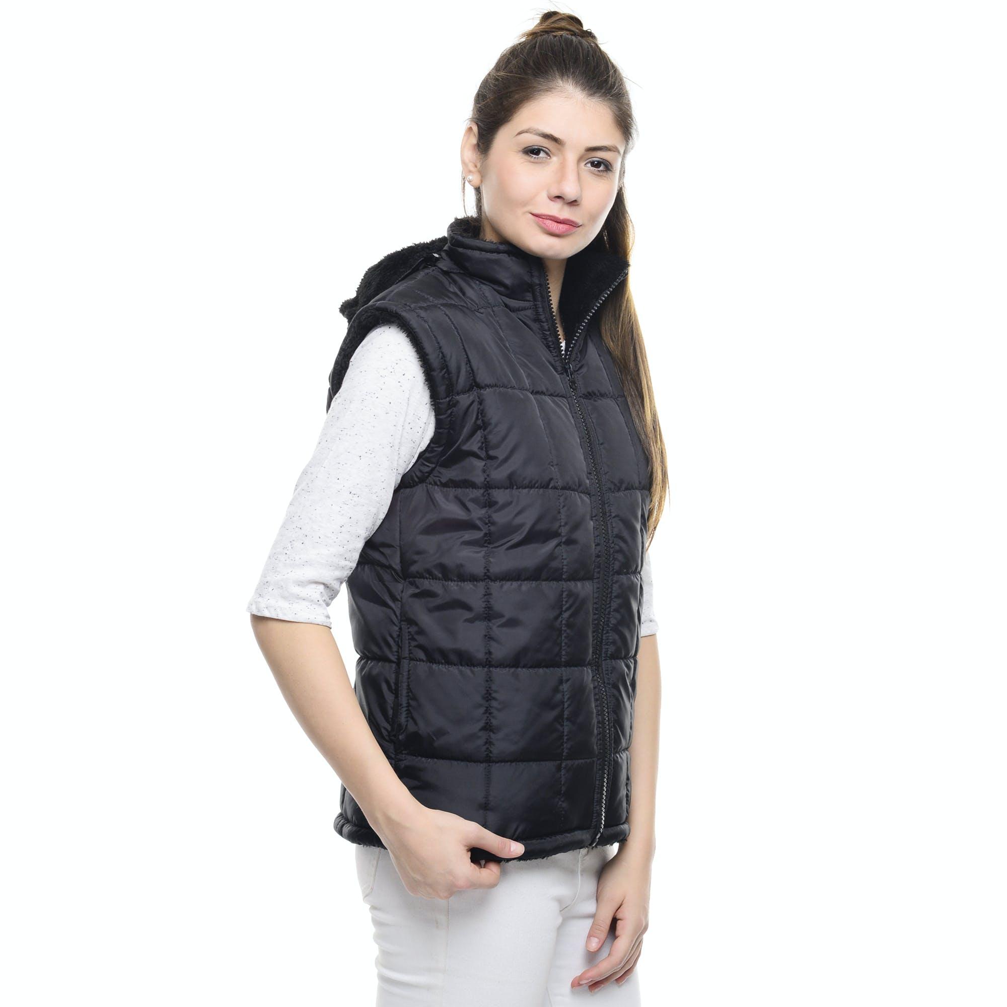 Woman Standing Wearing Black Bubble Zip Turtleneck Vest