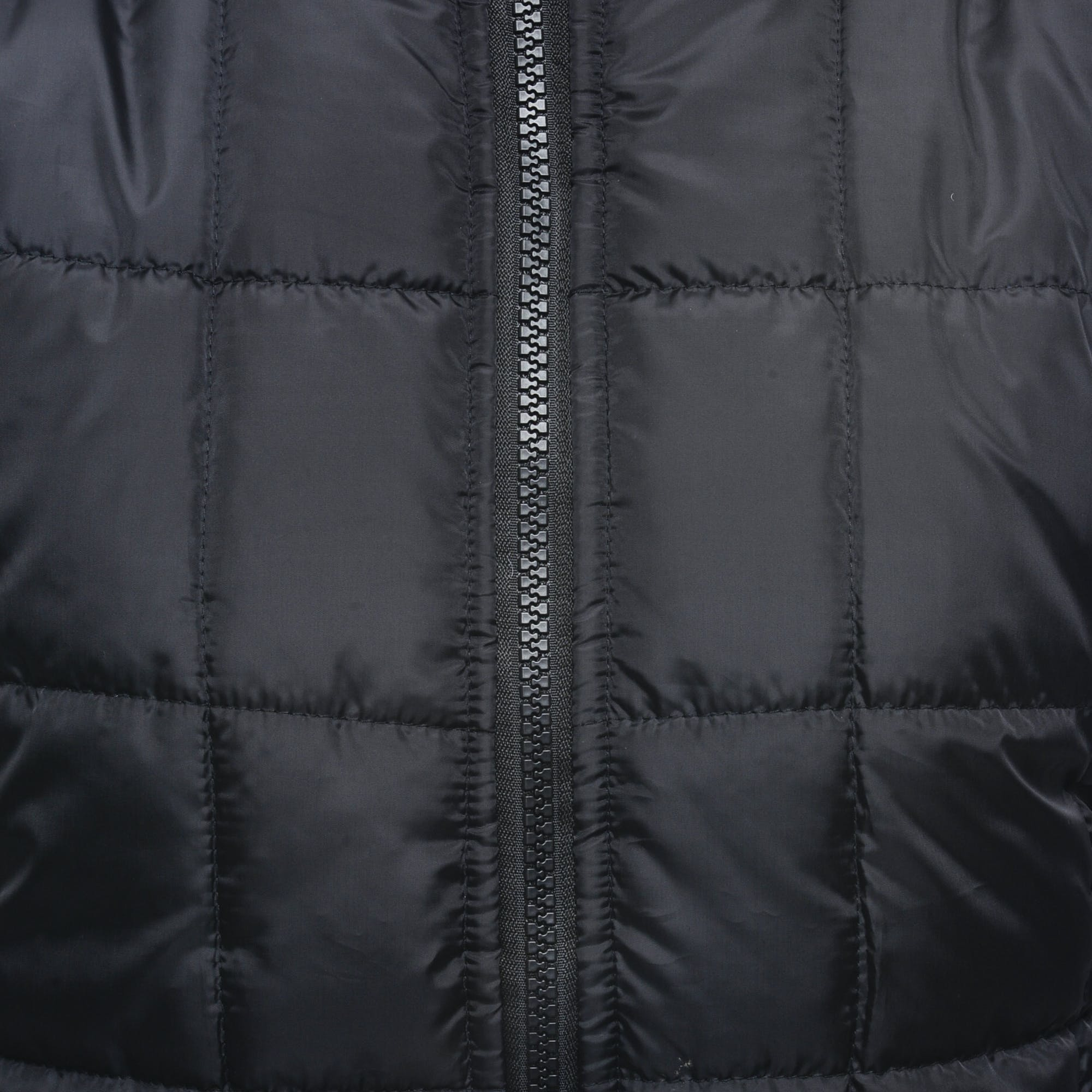 Close Up Shot of Black Zip Up Quilted Textile