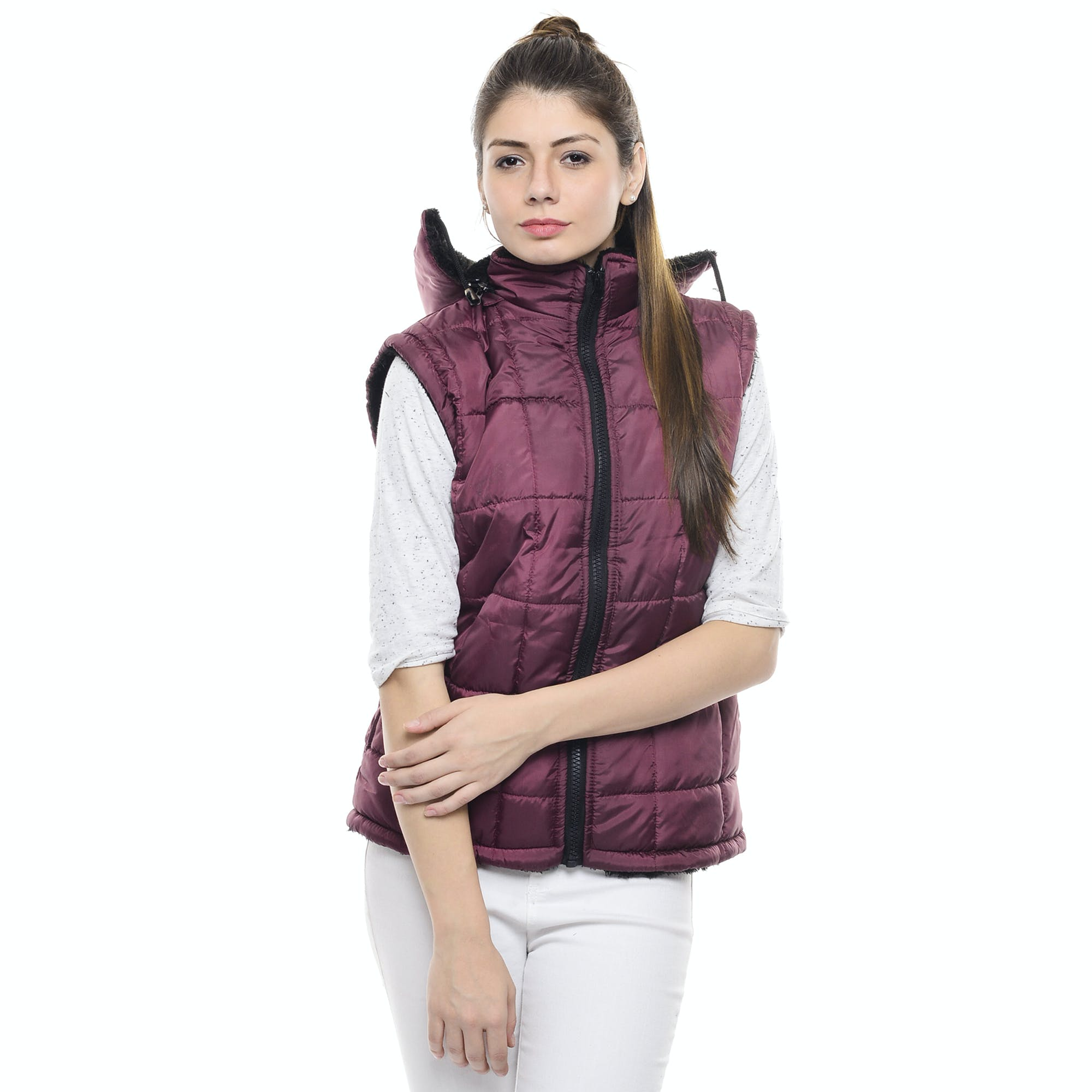 Woman in Pink Zippered Bubble Vest and White Jeans