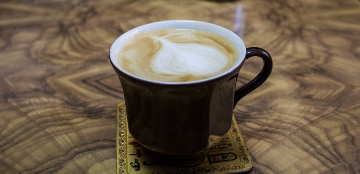 Cappuccino on Black Ceramic Mug