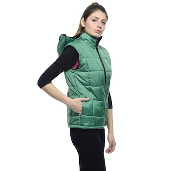 Woman Wearing a Green Puffer Vest and a Black Pants