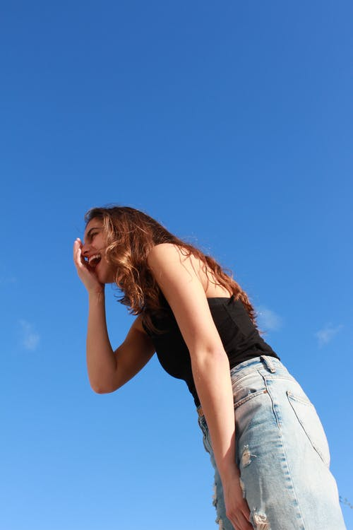 Low Angle Photo of Laughing Woman