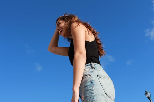 Free stock photo of blue jeans, blue sky, brown hair, girl