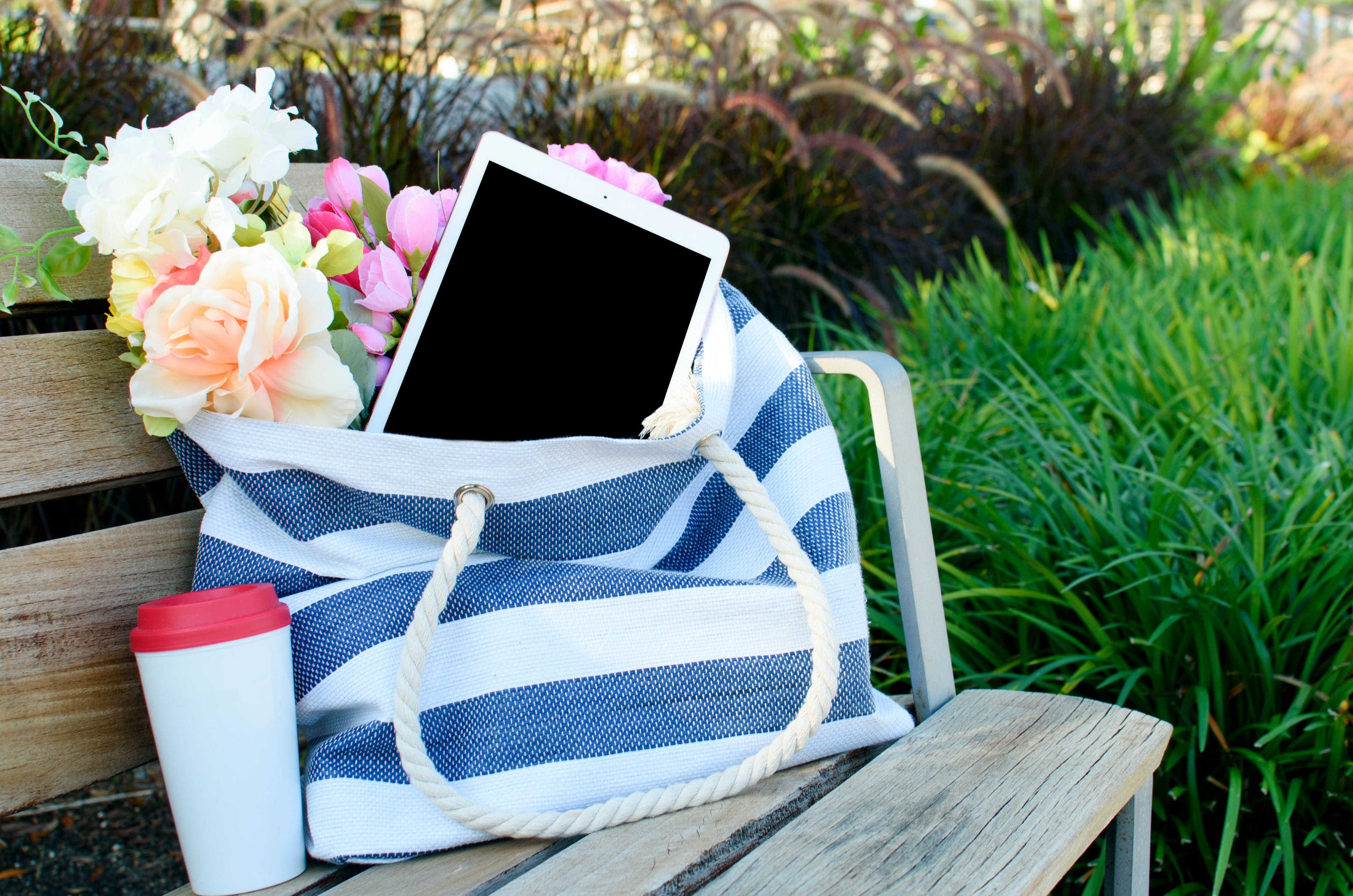 White Ipad With Black Screen in Tote Bag