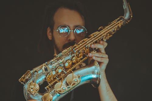 Man Holding Bras Saxophone