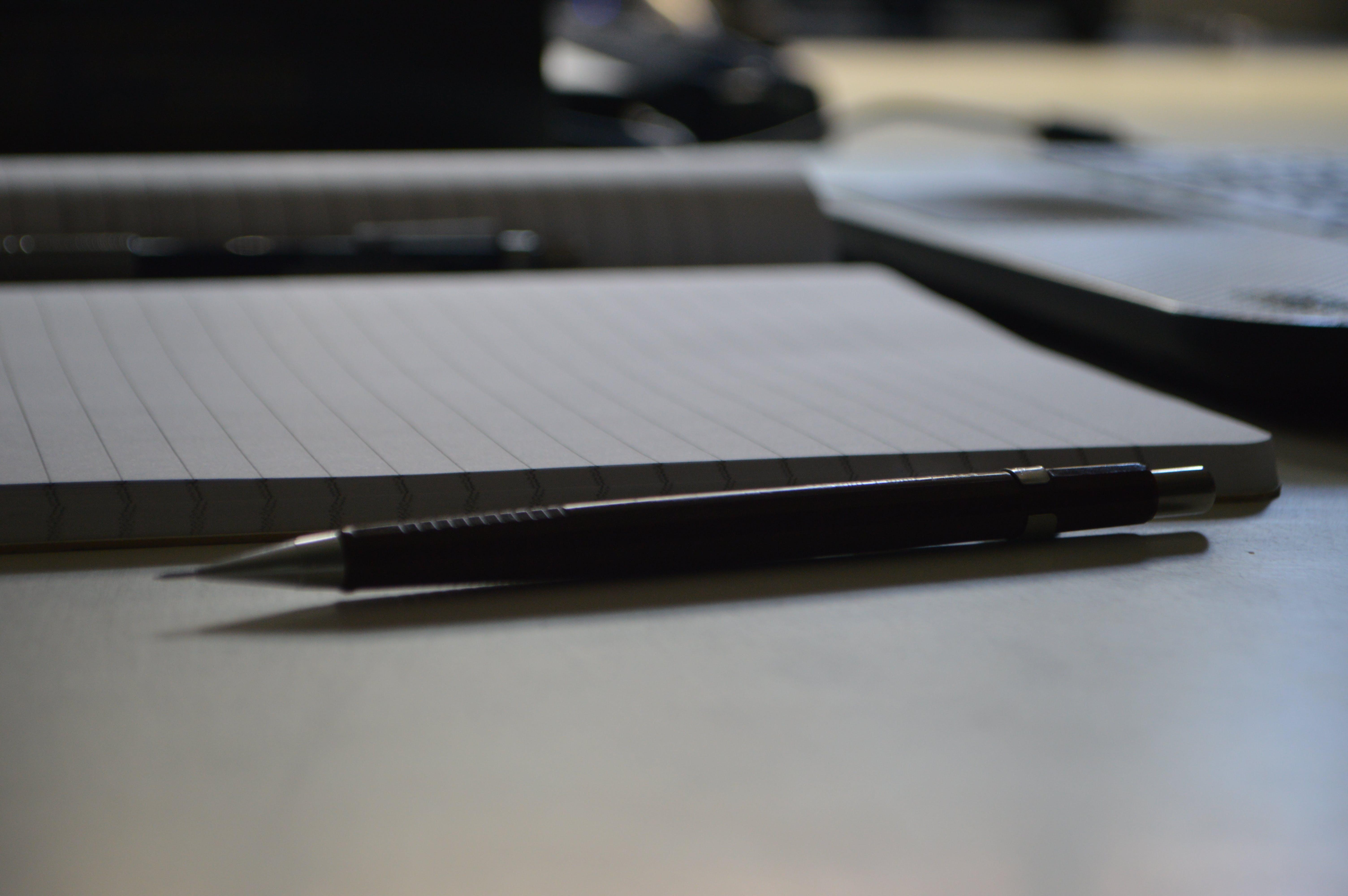 Black Point Pen Beside Ruled Paper