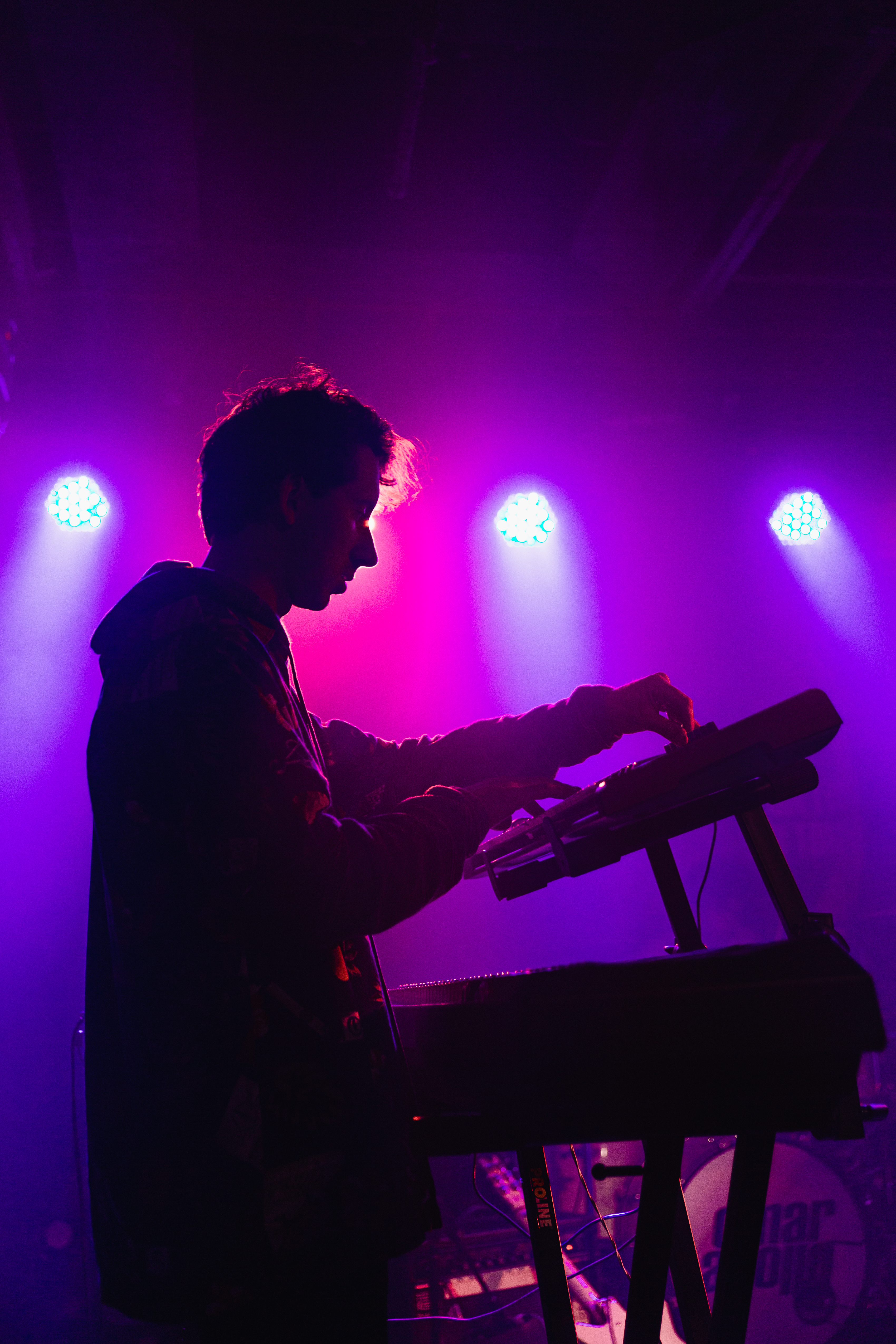 Man holding DJ mixer machine