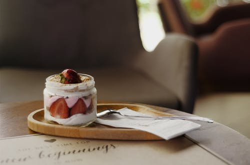 Strawberry Cake in Jar Beside Spoon
