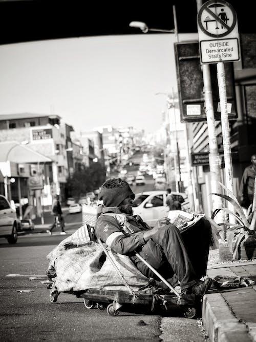 Free stock photo of black man, homeless, homelessness, reading