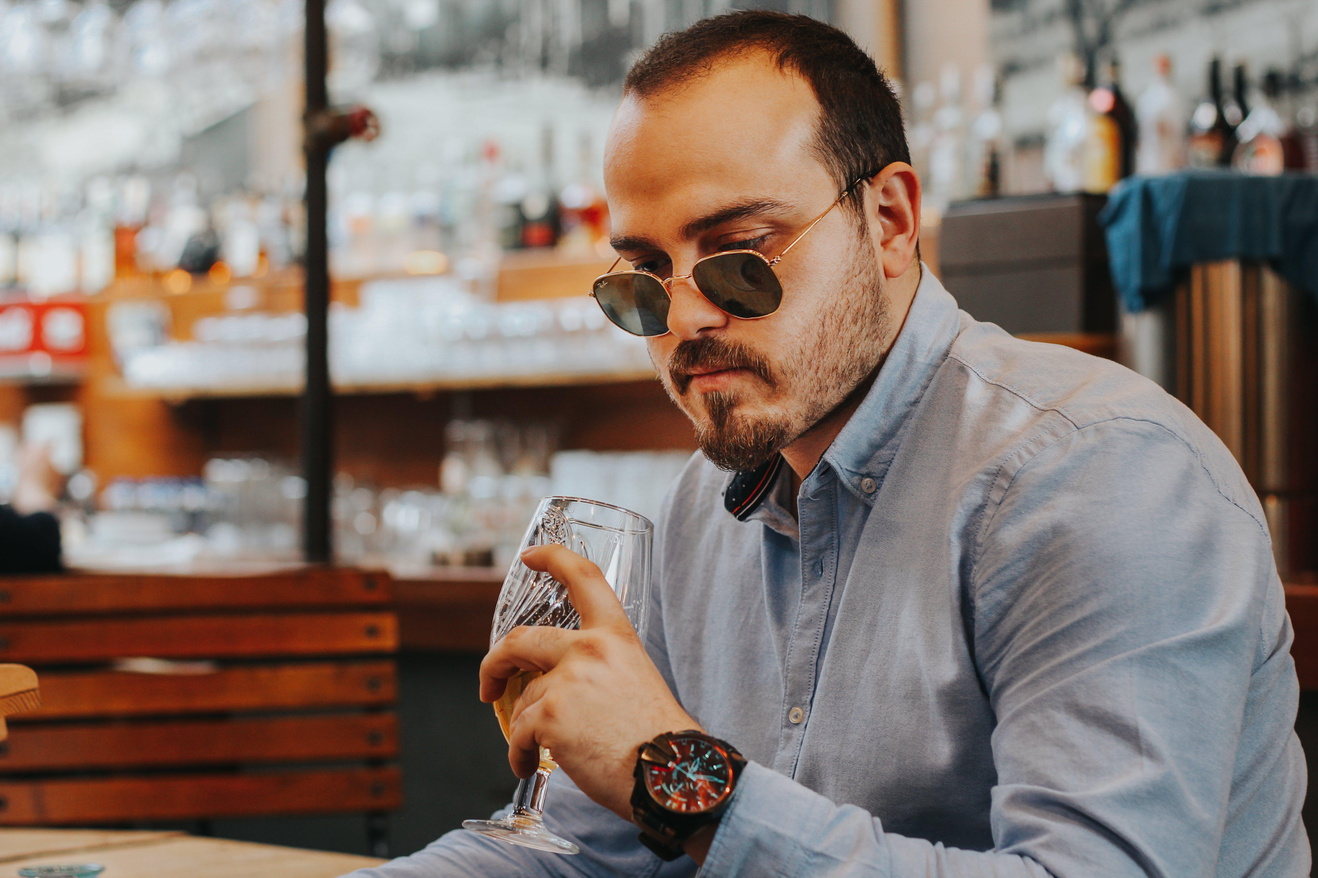 Man Wearing Dress Shirt While Drinking