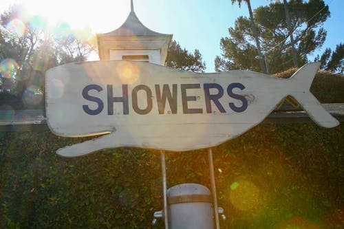 Free stock photo of beach, branding, showers, signs