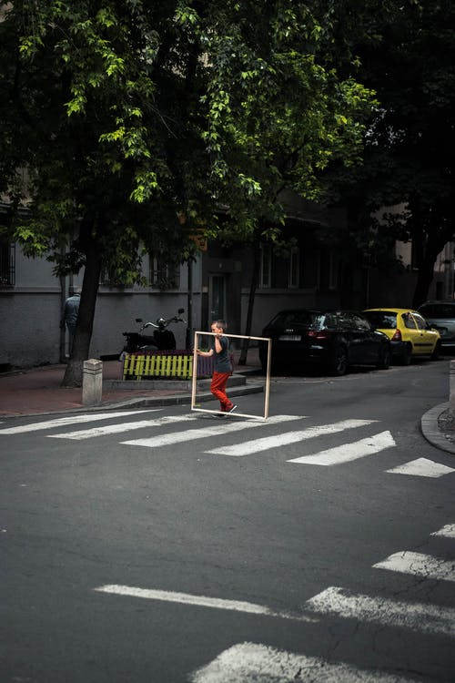 Boy Crossing The Street