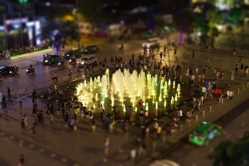 Fountain Surrounded by People during Nighttime