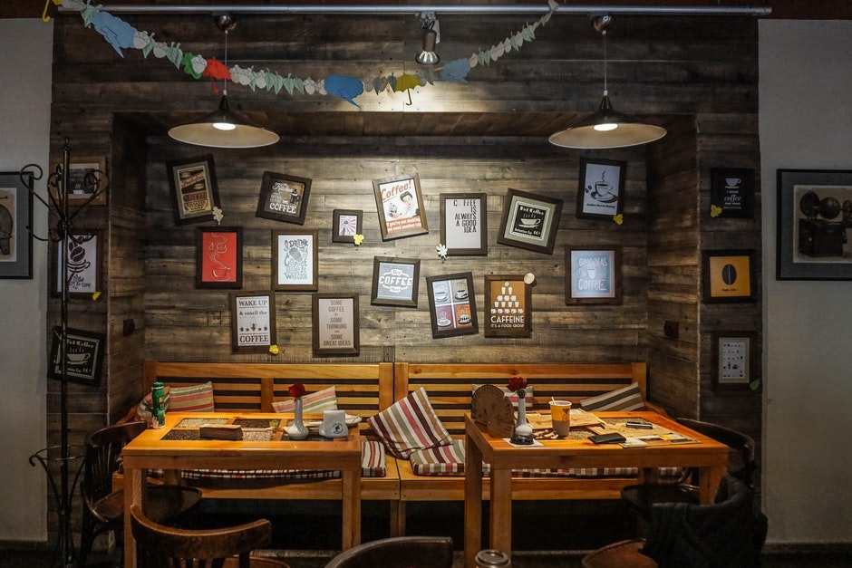 Dinning Tables Near Wall With Photo Frame Decor