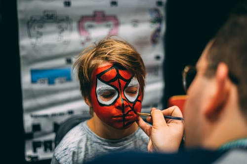 Man Painted Boy's Face