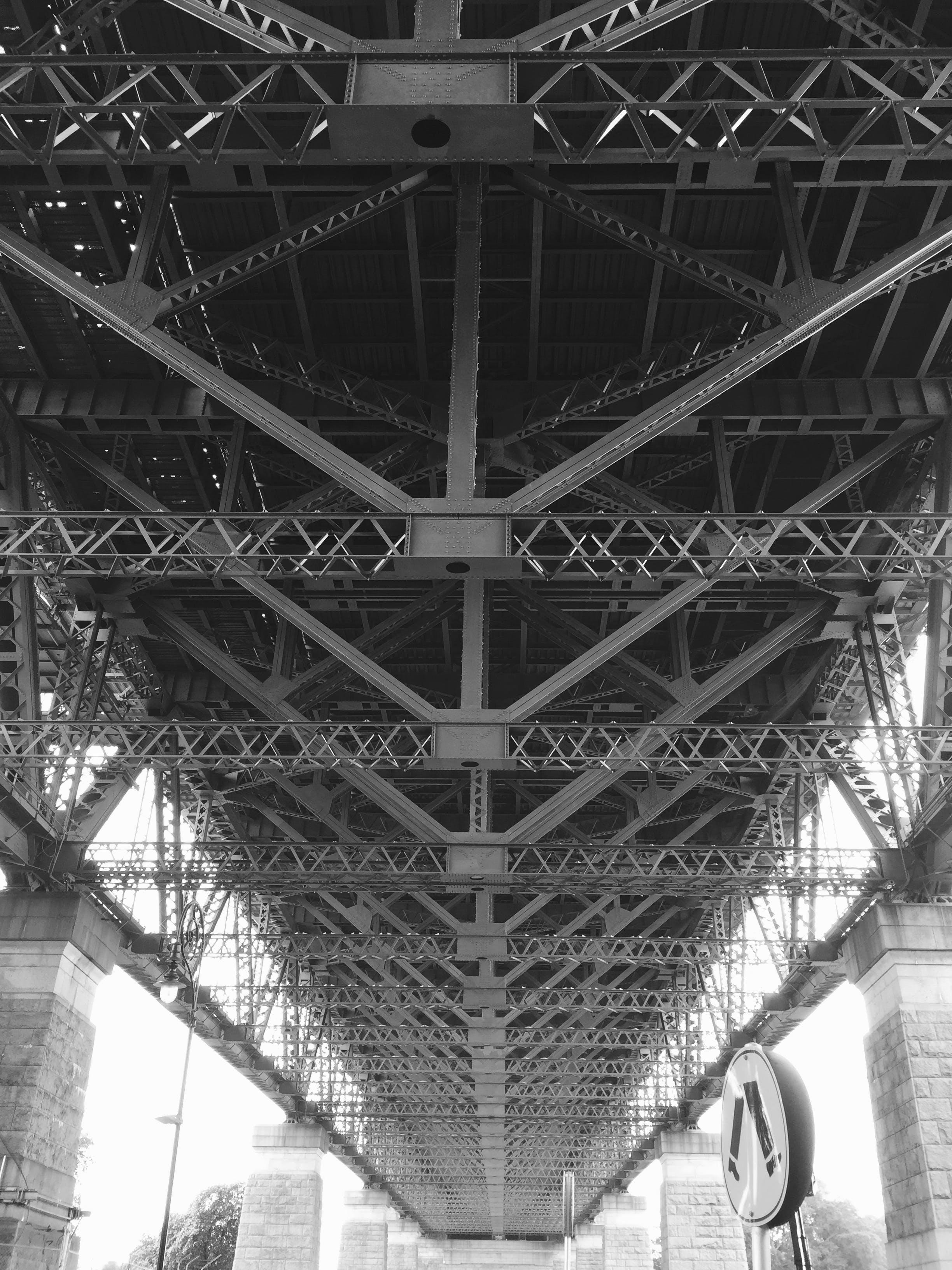 Grayscale Photo of Bridge Frame