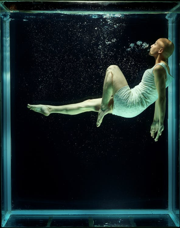 Woman Floating in Aquarium