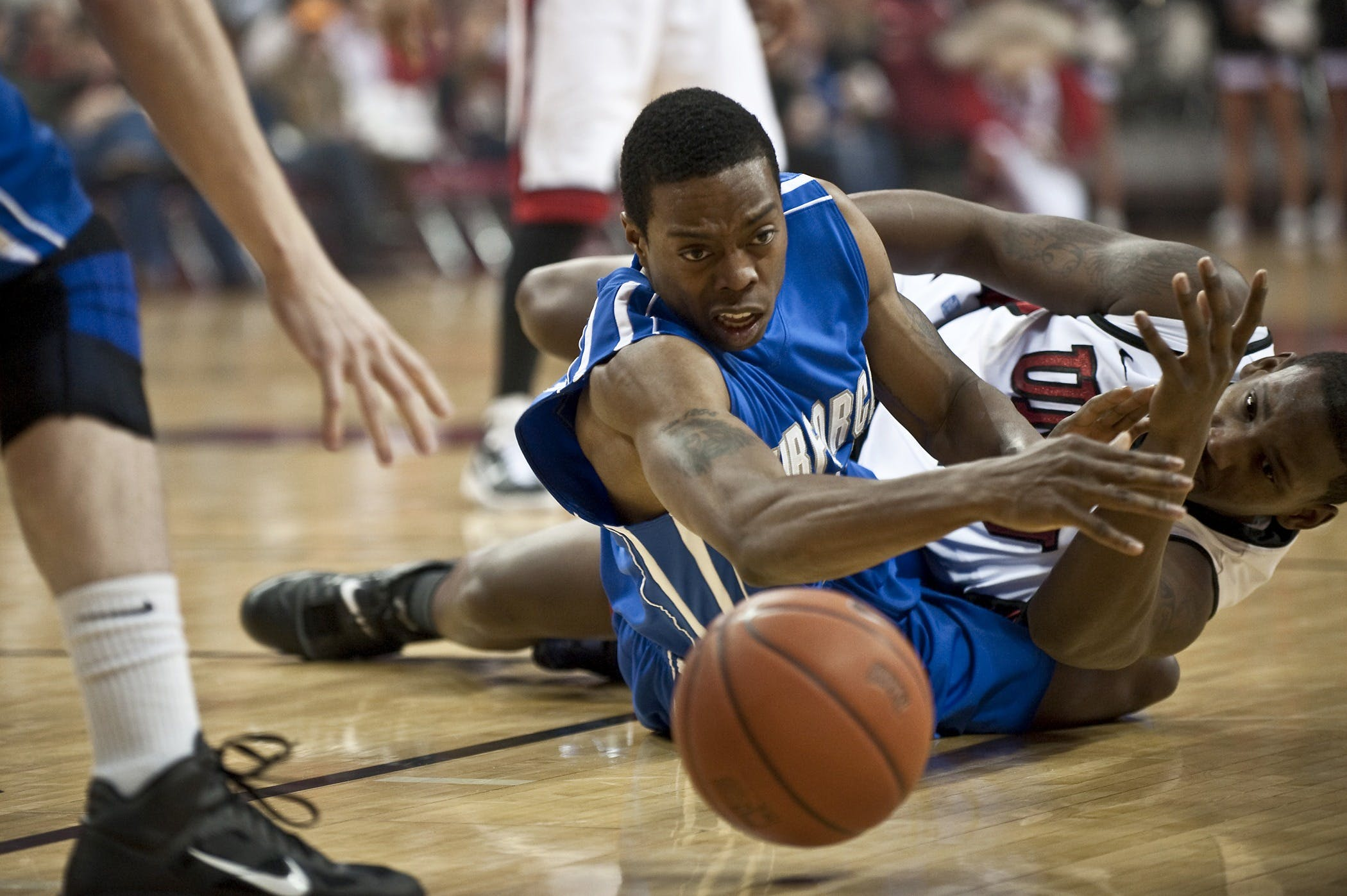 Two Basketball Players on Floor