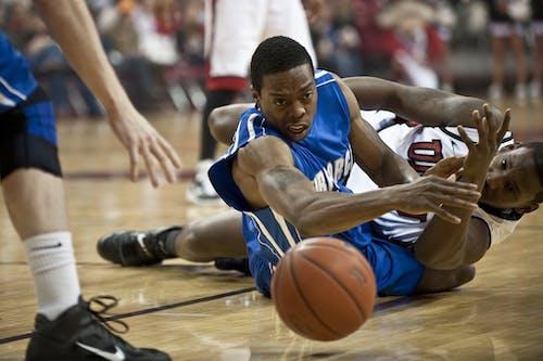 Two Basketball Players on Floor