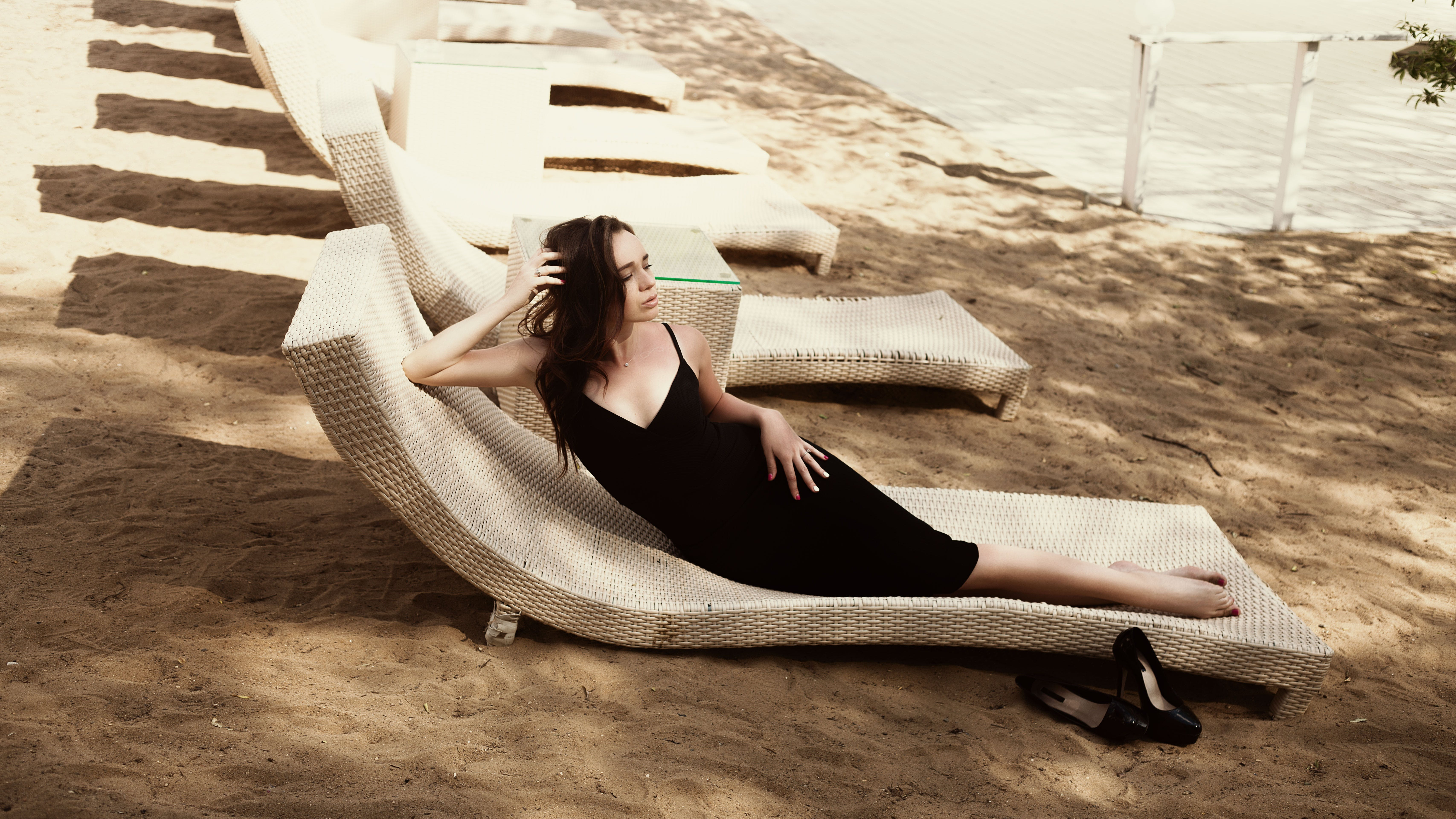 Woman Laying on Beige Lounger