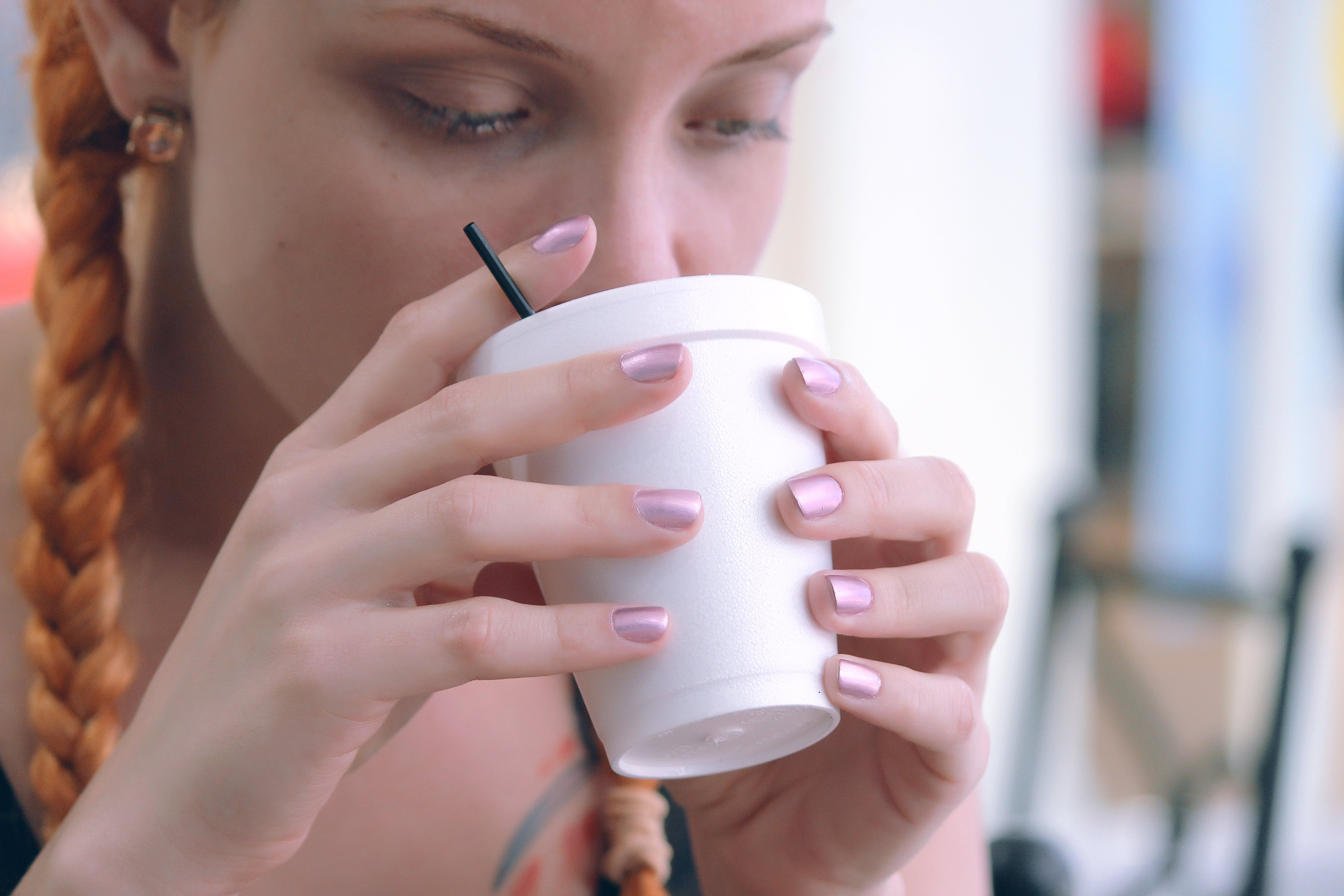 Girl Drinking from White Cup