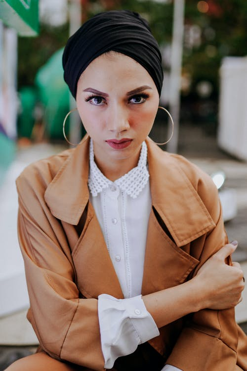Portrait Photo of Woman in Black Turban and Brown Leather Jacket