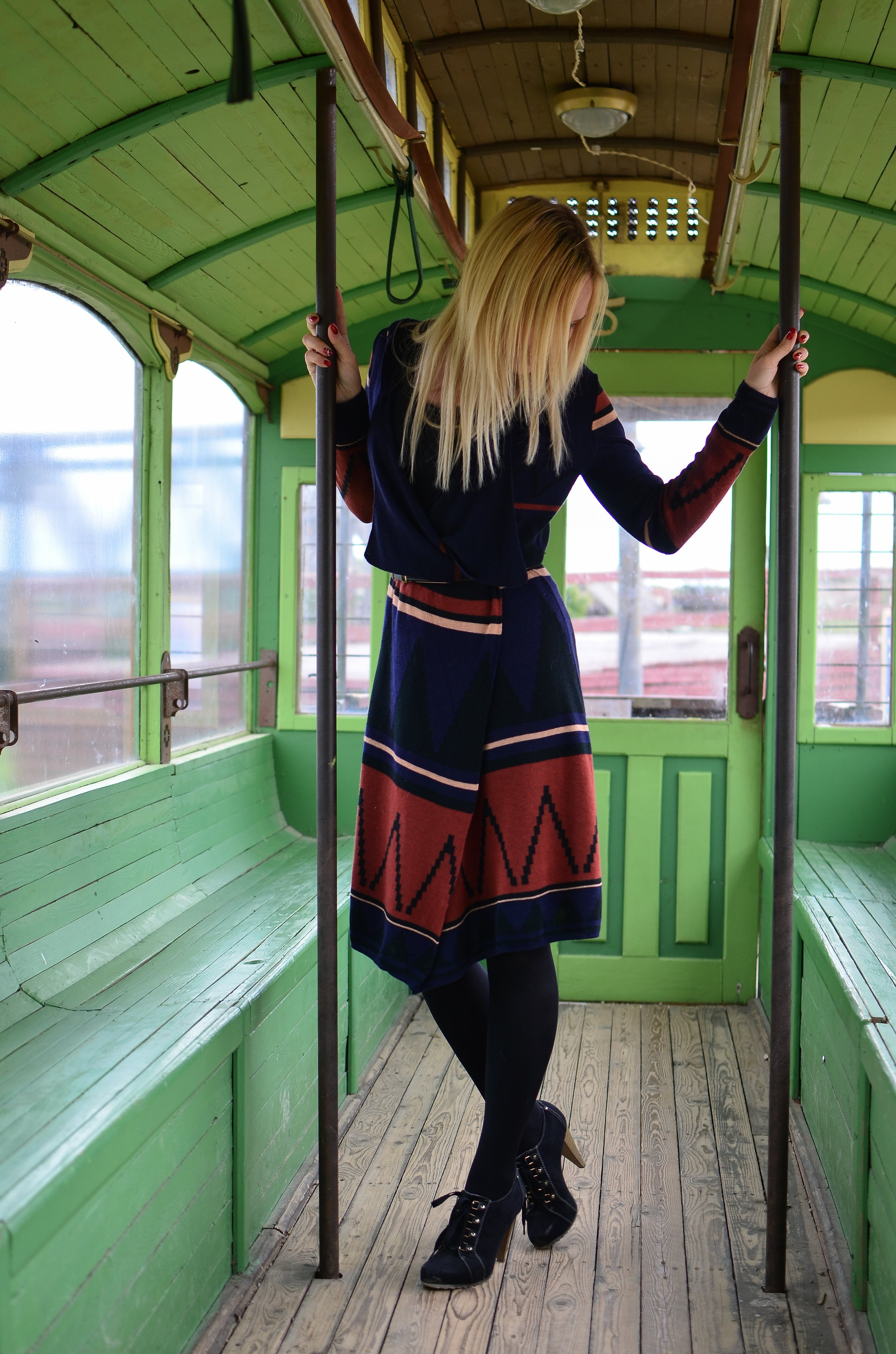 Woman Standing Inside the Bus