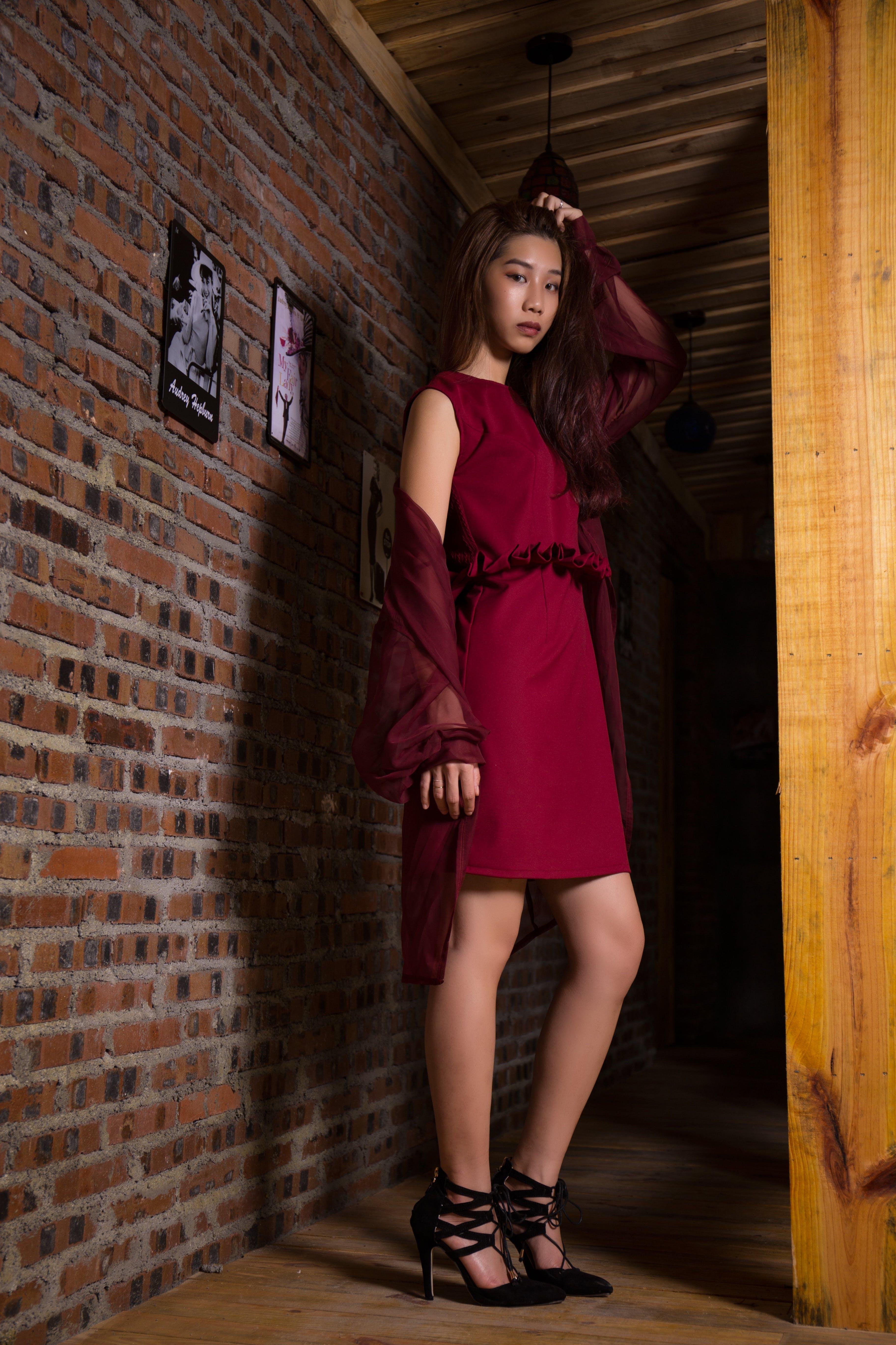 Woman Posing Wearing Red Dress