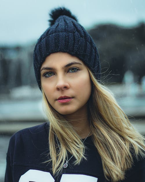 Photo of Woman in Black Beanie Hat and Black Top